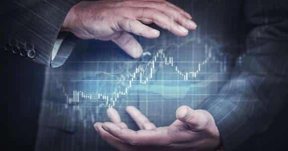 businessman holding investing globe future concept getty 573x300 - بورس های بین المللی